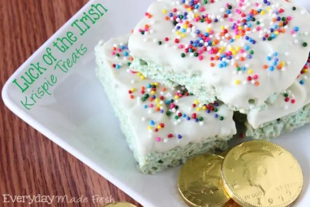 Luck of the Irish Krispie Treats are green for St. Patrick's Day, dipped in white chocolate and decked out with rainbow sprinkles! | EverydayMadeFresh.com
