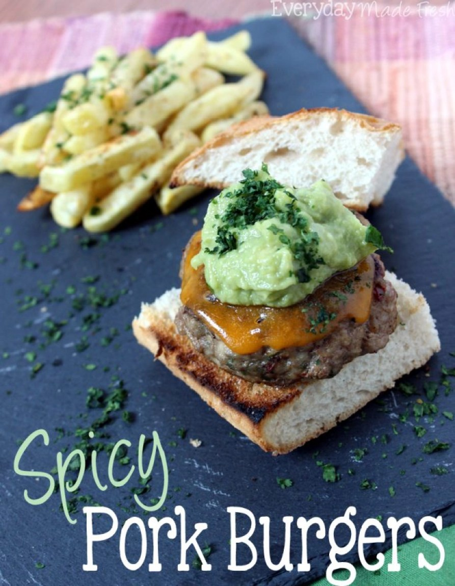 These Spicy Pork Burgers are a great way to change up your traditional burger. Spiced with chipolte peppers and topped with cheese and guacamole, they will quickly become your favorite! | EverydayMadeFresh.com