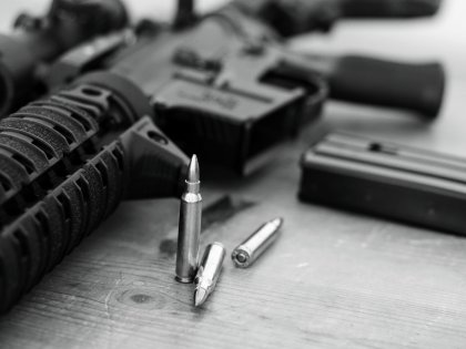 .223 cartridges in front of AR-15