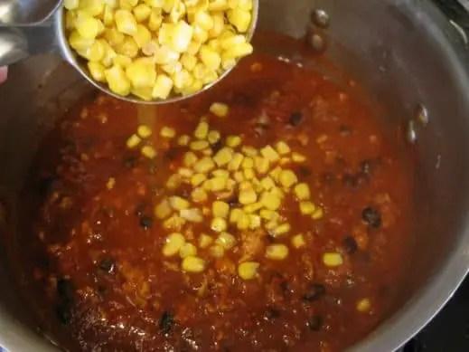 adding frozen sweet corn to turkey black bean chili