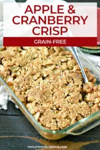 close up of apple cranberry crisp in a glass baking dish