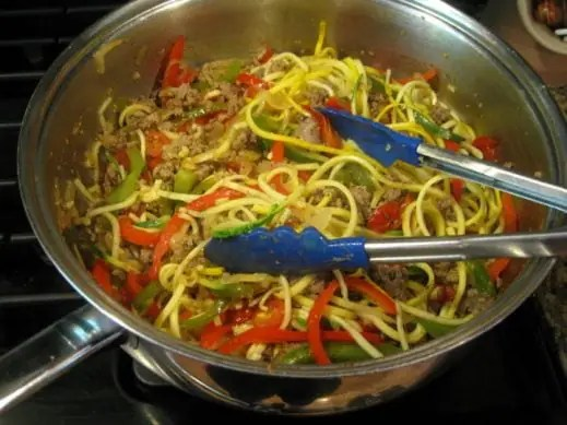 Sausage and Peppers over Zucchini Noodles from www.EverydayMaven.com