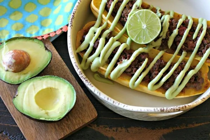 Taco Meat Stuffed Delicata Squash with Avocado Crema from www.EverydayMaven.com