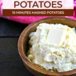 wood bowl of mashed potatoes made in the instant pot topped with a tab of butter