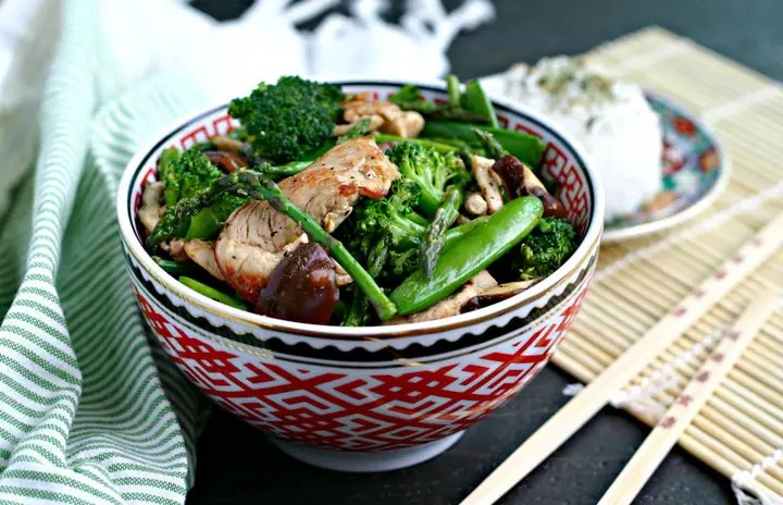 Chicken Stir Fry with Asparagus, Broccoli, Snap Peas and Mushrooms in a Bowl