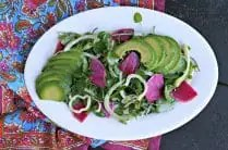 oval white platter with watercress salad, avocado, fennel and watermelon radish