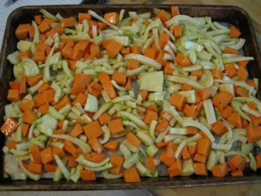 baking sheet with sliced fennel and diced sweet potaotes about to go in the oven