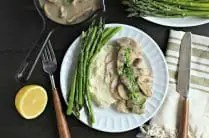 white dinner plate with asparagus, mashed cauliflower and instant pot poached chicken breast with creamy mushroom sauce