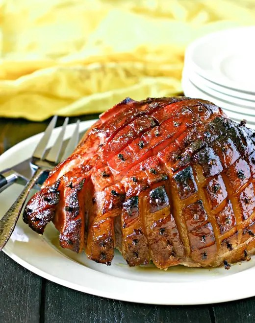 maple glazed smoked ham with serving plates