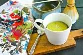matcha mug cake with floral linen and mixing bowl