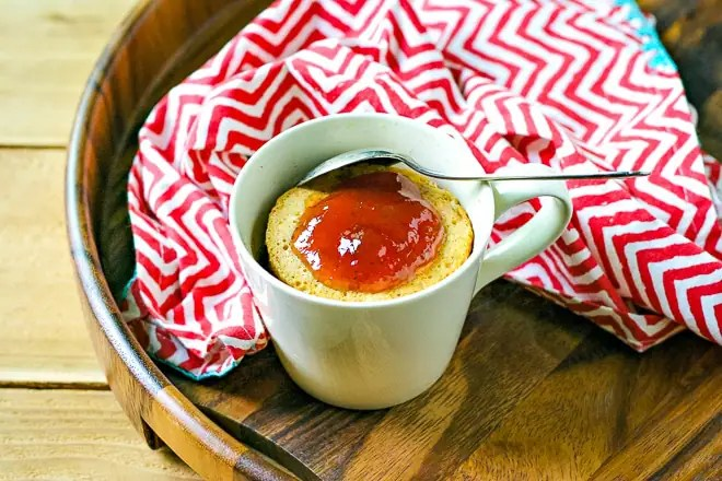 peanut butter mug cake on a tray with a red striped napkin