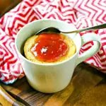 Peanut Butter Mug Cake topped with strawberry jelly