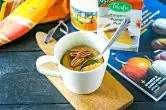 paleo mug cake made with pumpkin topped with pecans
