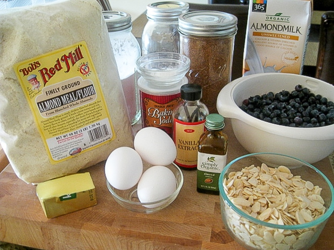 ingredients to make gluten-free blueberry muffins on a cutting board