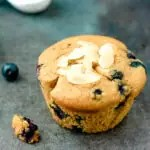 close up of paleo blueberry muffin with sliced almonds on top