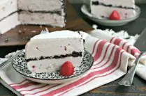 slice of gluten free ice cream cake on a plate with a strawberry