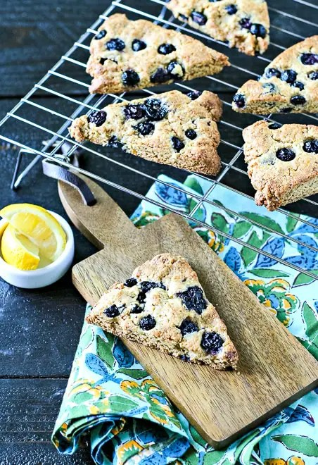 freshly baked blueberry scones on a cooling rack