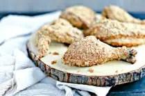 wood platter of baked paleo fried chicken