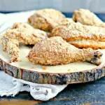 crispy baked chicken on a wood serving platter
