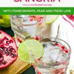 close up of winter sangria in short glass with pomegranate arils
