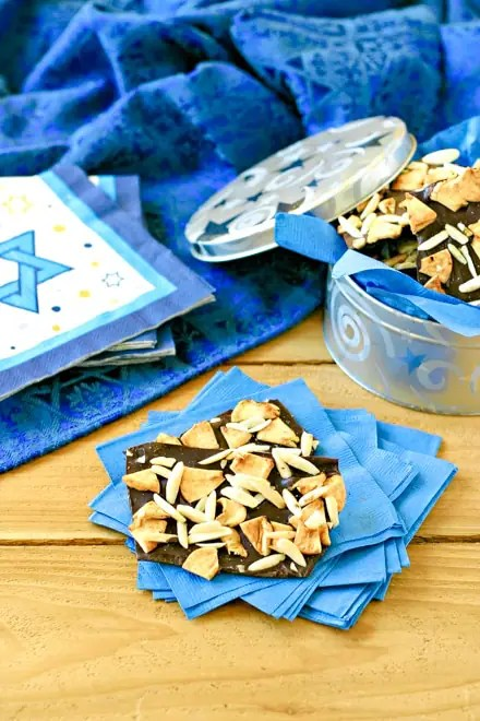 homemade hanukkah candy with a large blue table linen