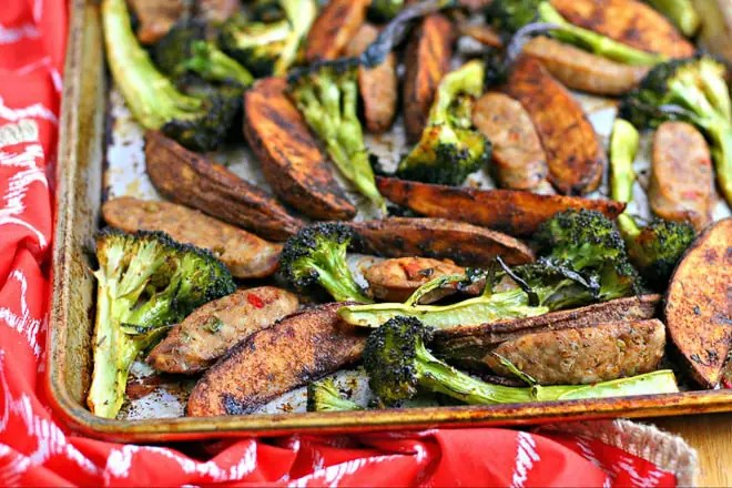 sheet pan with cooked sausage, potatoes and broccoli