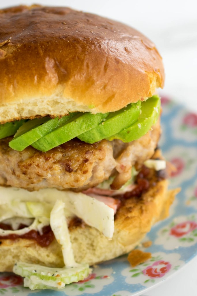 Mince some chicken thighs with smoked bacon to make these insanely tasty burgers! Then pile them high with Ranch Slaw and avocdo. a