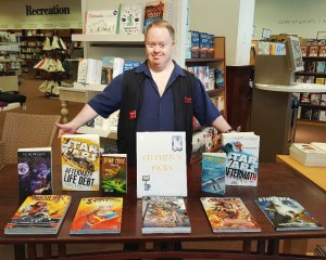 """Stephen Whiteside shows off his selections for Chapter's """"Staff Picks"""" table."""