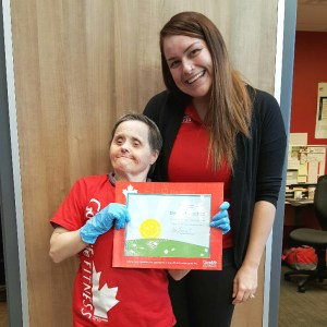South Team client Eileen McLaughlin is recognized by her manager at Canyon Meadows GoodLife Fitness.