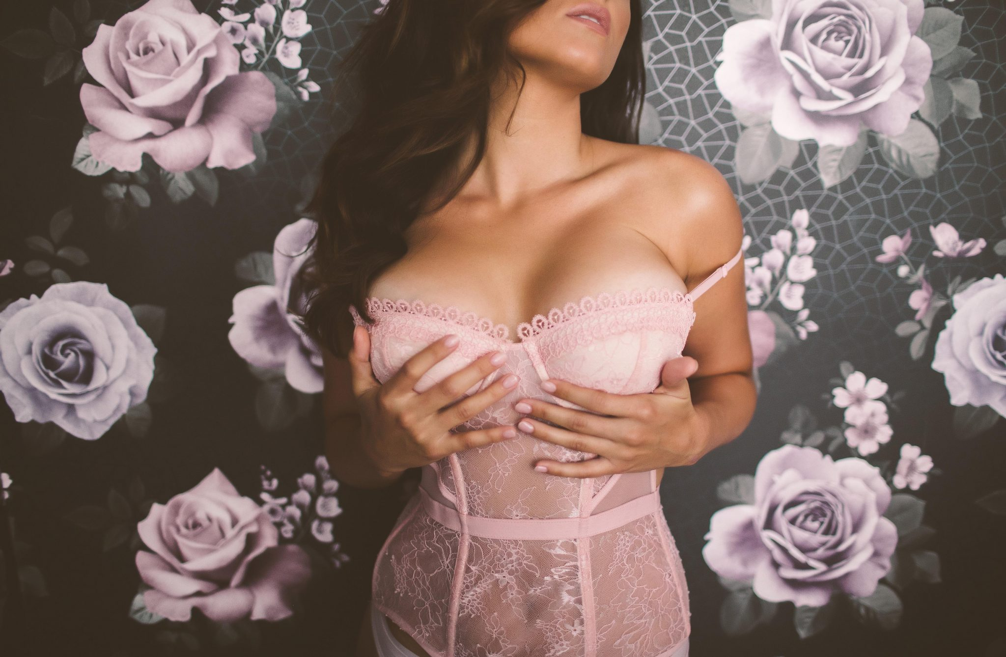 A NYC boudoir model wearing pink lingerie