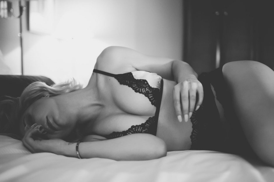 A woman in a dramatic boudoir pose