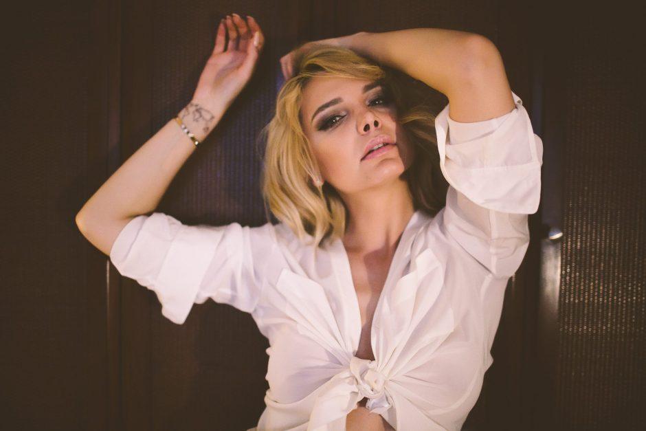A sexy model wearing a white shirt