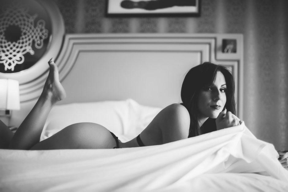 A woman taking classy boudoir photos for a wedding