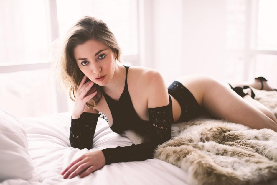 A woman posing in fancy black lingerie