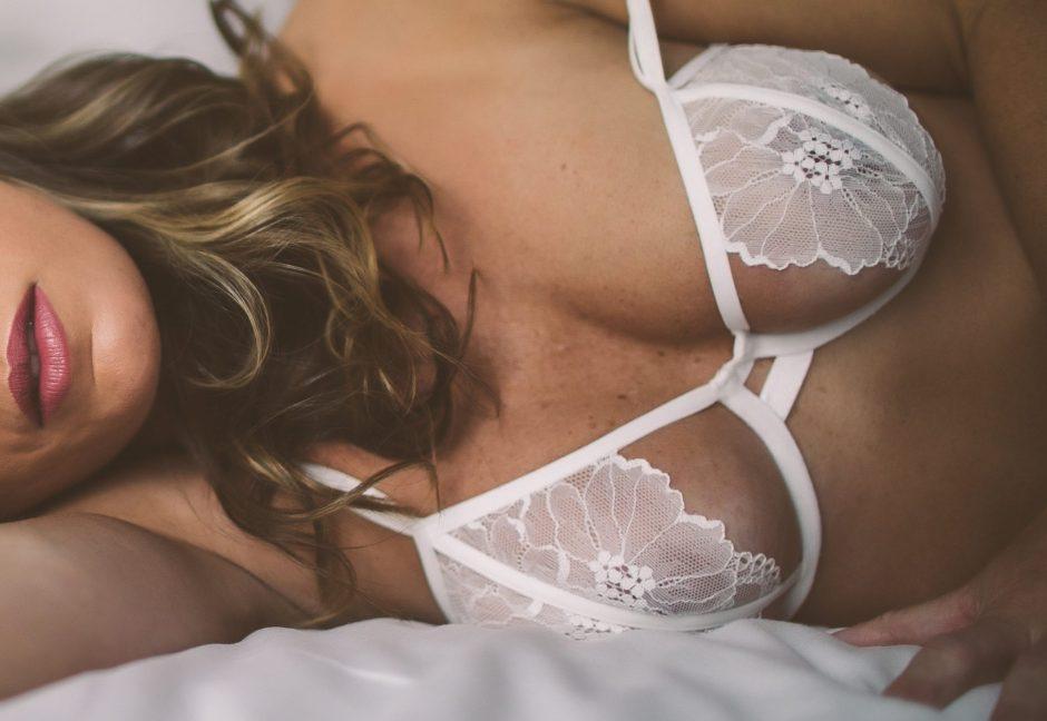 Close up shot of a boudoir model wearing a white bra