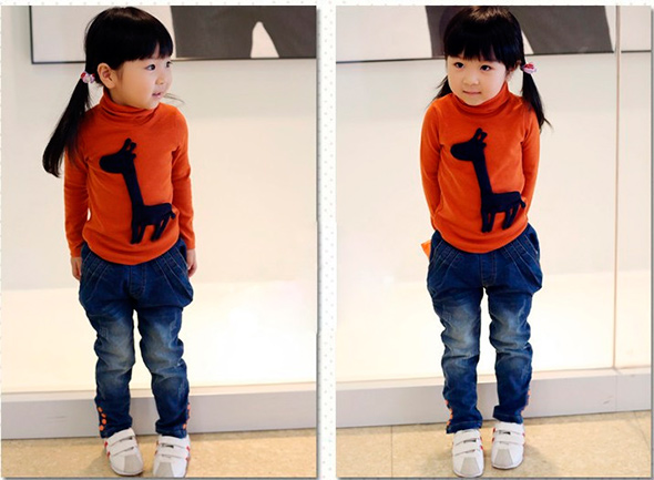 little-girl-in-stylish-jeans-and-a-sweater
