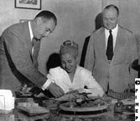 Evita with her brother Juan Duarte and Raul Apold