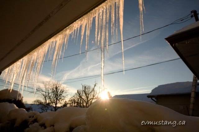 image of icicles hanging from the eaves