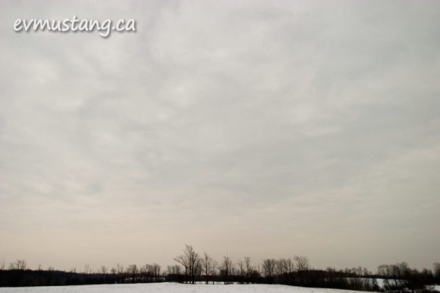 image of mottled clouds over snowy field