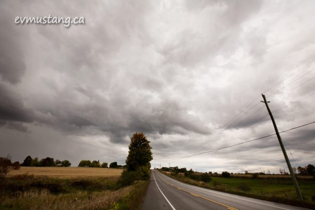 image of rain clouds over autumn landscape