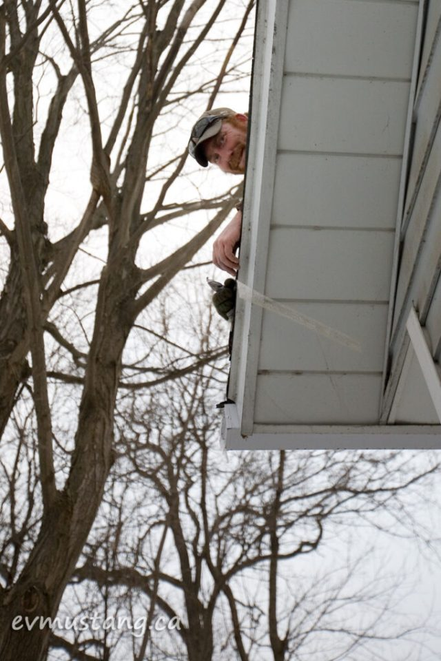 image of roofer working in freezing cold