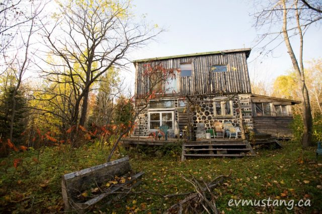 image of log cabin in northern ontario forest in autumn