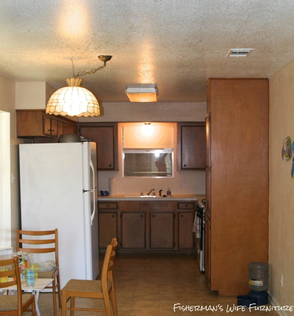 orange-kitchen-before-the-makeover-Fishermans-Wife-Furniture-featured-on-Remodelaholic