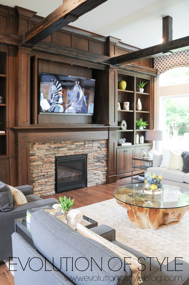 Stone fireplace with stained wood surround
