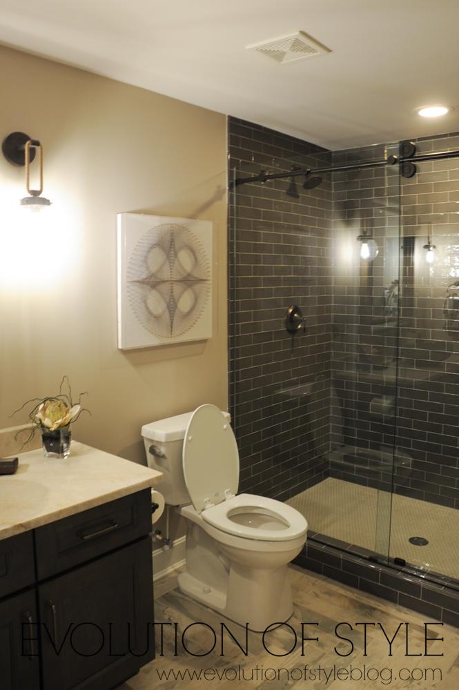 Basement Bathroom with dark subway tile