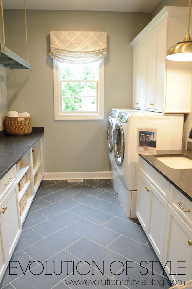 Laundry room with dark tile floor