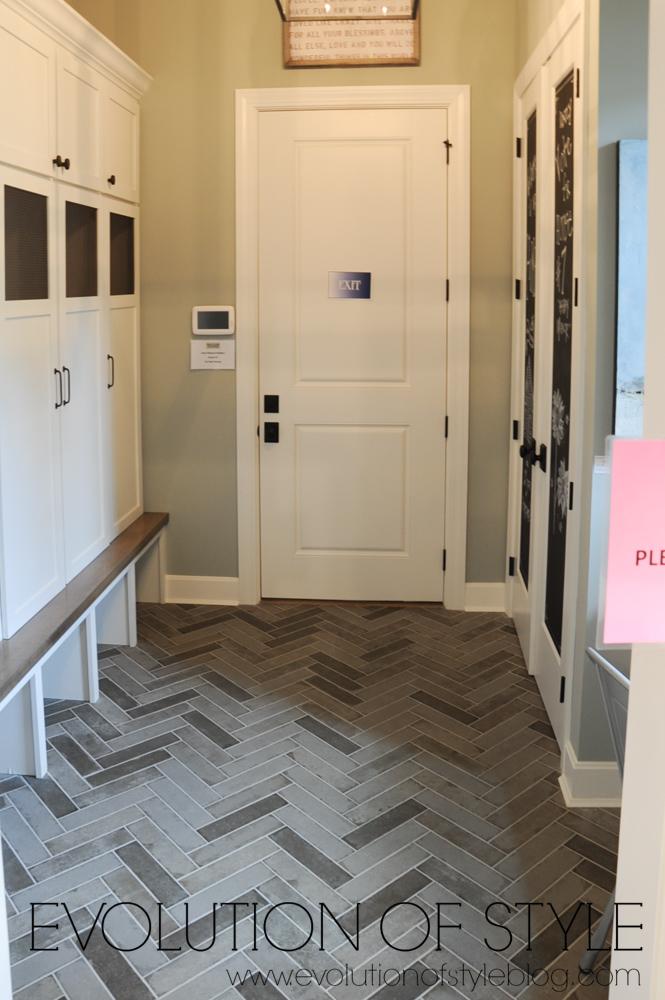 Mudroom with herringbone tile floor
