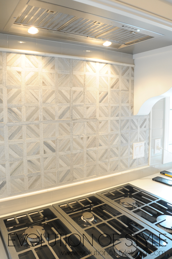 Gray mosaic tile backsplash