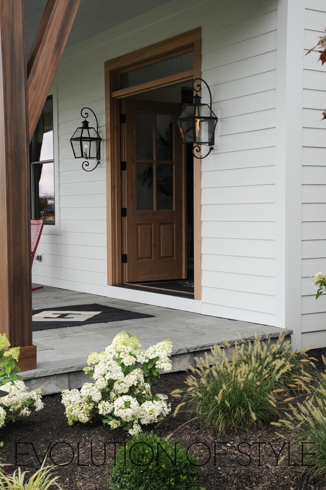 Modern farmhouse with exterior gaslamps