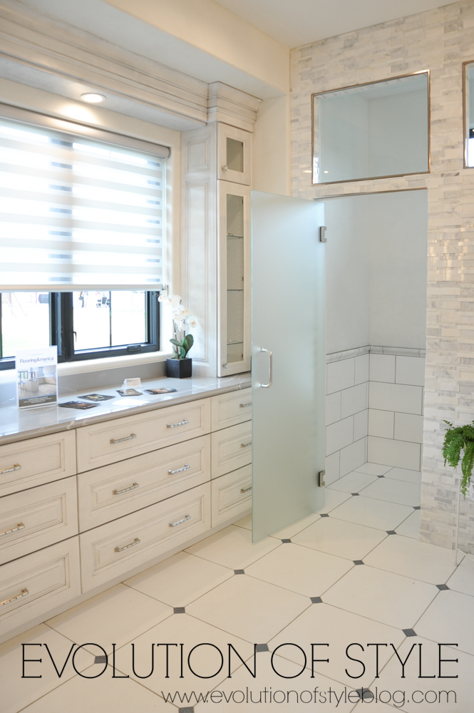 Modern farmhouse master bathroom with white cabinets